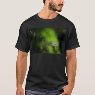 Dandelion seed head and wind blown seeds T-Shirt