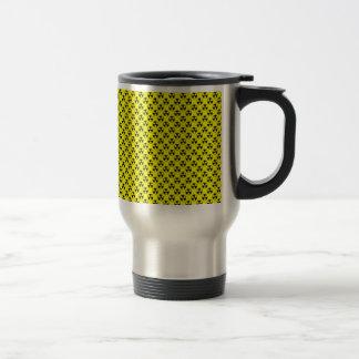 Dangerous black radioactive sign on yellow surface mug