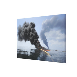 Dark clouds of smoke and fire emerge canvas print