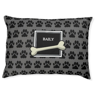 Dark gray dog paws  and bone monogram name pet bed