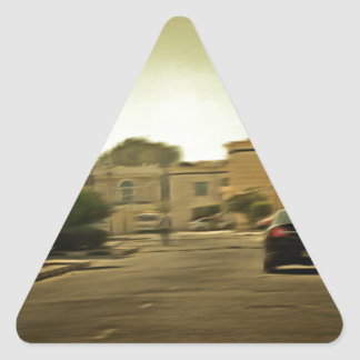 Dark hues in a residential neighborhood with vill triangle sticker