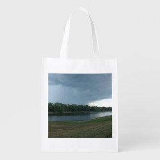 Dark Menacing Storm Cloud over a Lake valley
