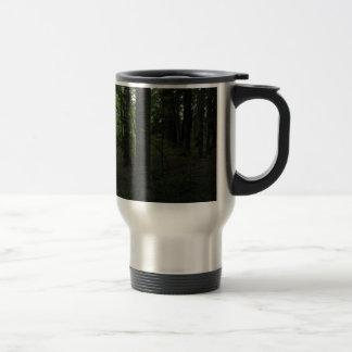 Dark mysticalforest in mid-day travel mug