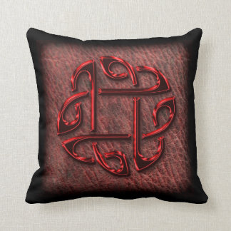 Dark red celtic knot on leather cushion