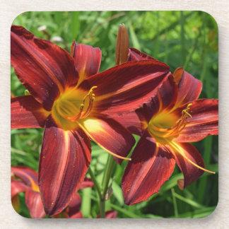 Dark red lilies hard plastic coasters