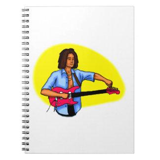 Dark skinned guitar player tuning pink red guitar note books