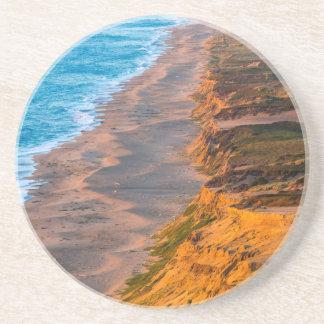 Days Last Light Strikes The Sandy Shore Of Point Coaster