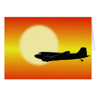 DC-3 passing sun. Card