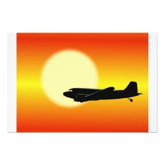 DC-3 passing sun Photo