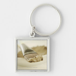 Dead sea mask, close up Silver-Colored square key ring