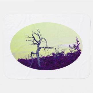 dead tree purple yellow leaves sky receiving blankets
