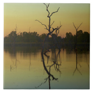 Dead trees reflected in Lily Creek Lagoon, dawn Large Square Tile