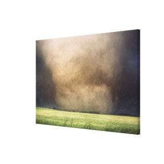 Debris flies just after this violent tornado destr canvas print