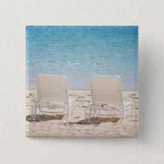 Deck chairs on sandy beach 15 cm square badge
