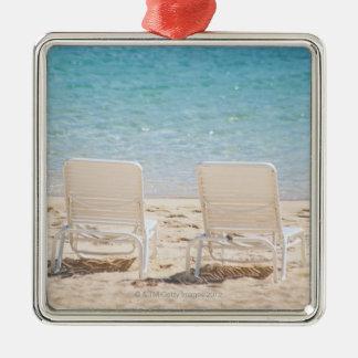 Deck chairs on sandy beach christmas ornament