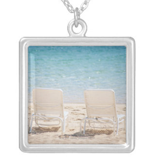 Deck chairs on sandy beach silver plated necklace