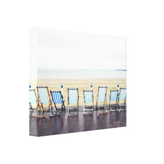 Deckchairs on a Wet and Deserted Beach Canvas Print
