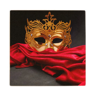 Decorated mask for masquerade on red velvet wood coaster
