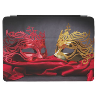 Decorated masquerade mask on red velvet iPad air cover
