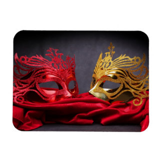 Decorated masquerade mask on red velvet magnet