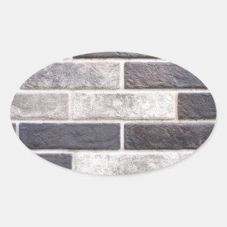 Decorative brickwork of white and black bricks oval sticker