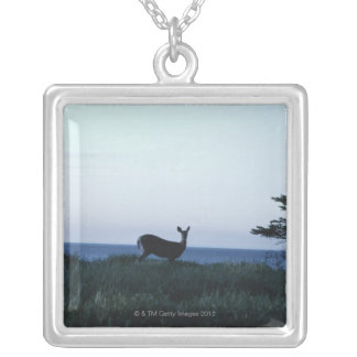 Deer in field by ocean silver plated necklace