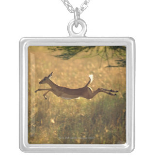 Deer leaping through field silver plated necklace