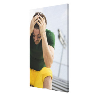 Defeated Football Player with Head in Hands Stretched Canvas Prints