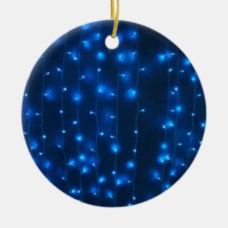 Defocused and blur image of garland of blue LED li Round Ceramic Decoration
