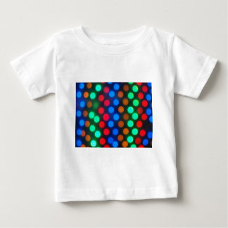 Defocused and blur image of multi-colored lights tee shirt