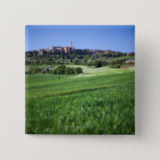 defocused grainfield with on pienza, tuscany, 15 cm square badge