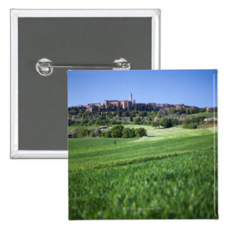 defocused grainfield with on pienza, tuscany, 15 cm square badge