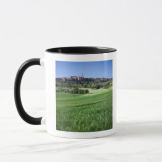 defocused grainfield with on pienza, tuscany, mug