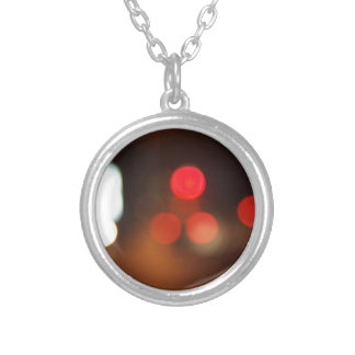 Defocused lights from the headlights and tail ligh round pendant necklace