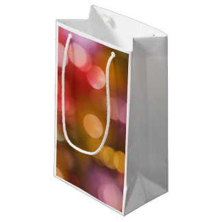 Defocused red and orange fairy lights small gift bag