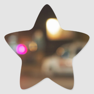 Defocused silhouette of the car and traffic lights star sticker