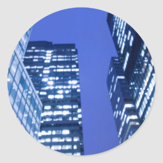 Defocused upward view of office building windows classic round sticker
