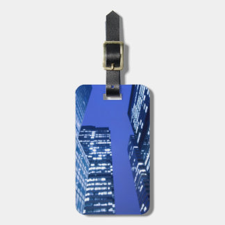 Defocused upward view of office building windows luggage tag