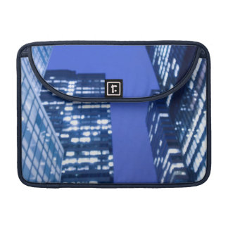 Defocused upward view of office building windows sleeve for MacBooks