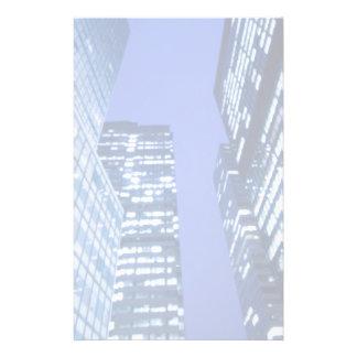 Defocused upward view of office building windows stationery paper