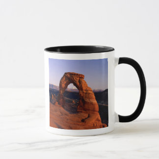 Delicate Arch at Sunset with snow covered La Mug