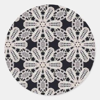 Delicate lace fabric patterns in black & white classic round sticker