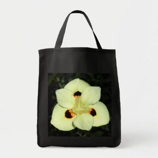 Delicate white orchid like flower tote bag