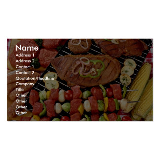 Delicious Barbecue with uncooked and cooked meat o Business Card