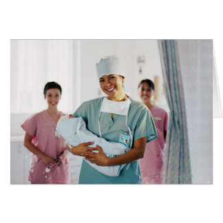 Delivery room nurse holding baby, nurses in greeting card