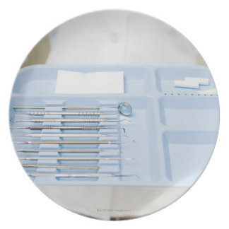 Dental hygienist  holding tray of dental party plate