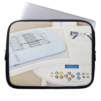 Dentist machinery, safety goggles and implements laptop sleeve