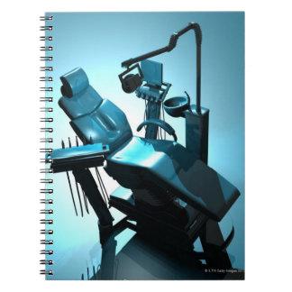 Dentist's chair, computer artwork. spiral notebook
