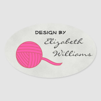 Design By... Pink Ball of Yarn and Sand Background Oval Sticker