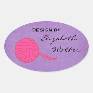 Design By... Pink Ball of Yarn Purple Background Oval Sticker